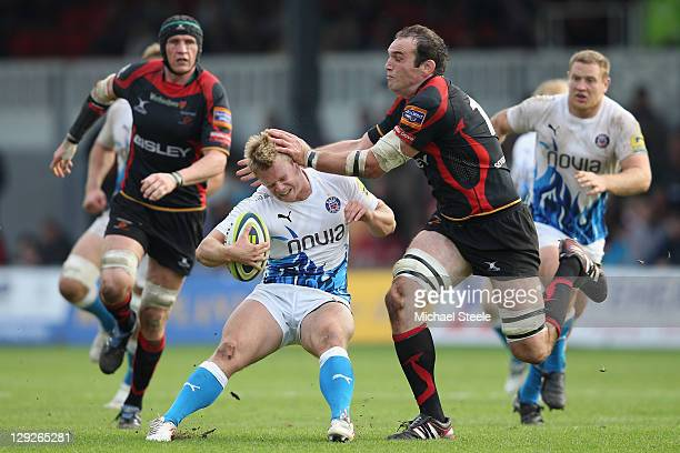Robert Sidoli of Newport Gwent Dragons grabs the head of Chris Cook of Bath during the LV Cup match at Rodney Parade on October 15 2011 in Newport...