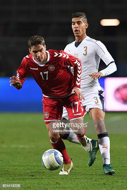 Robert Skov of Denmark is challenged by Adam Masina of Italy during the International Friendly match between Italy U21 and Denmark U21 at Stadio...