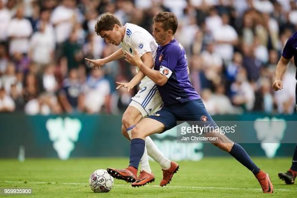 Robert Skov of FC Copenhagen and Jakob Poulsen of FC Midtjylland compete for the ball during the Danish Alka Superliga match between FC Copenhagen...