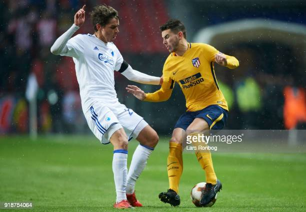 Robert Skov of FC Copenhagen and Lucas Hernandez of Club Atletico de Madrid compete for the ball during the UEFA Europa League round of 32 1 leg...