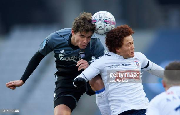Robert Skov of FC Copenhagen and Mustafa Amini of AGF Aarhus compete for the ball during the Danish Alka Superliga match between AGF Aarhus and FC...