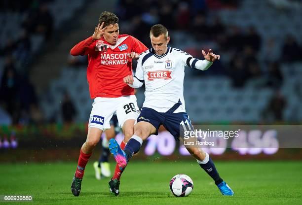 Robert Skov of Silkeborg IF and Danny Olsen of AGF Aarhus compete for the ball during the Danish Alka Superliga match between AGF Aarhus and...