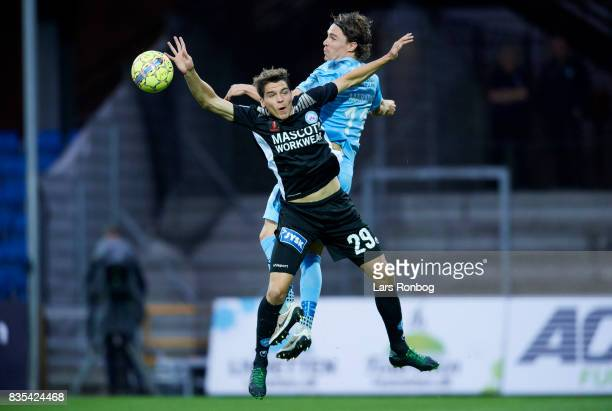 Robert Skov of Silkeborg IF and Erik Marxen of Randers FC compete for the ball during the Danish Alka Superliga match between Randers FC and...