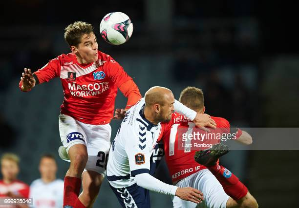 Robert Skov of Silkeborg IF and Mikkel Rask of AGF Aarhus compete for the ball during the Danish Alka Superliga match between AGF Aarhus and...