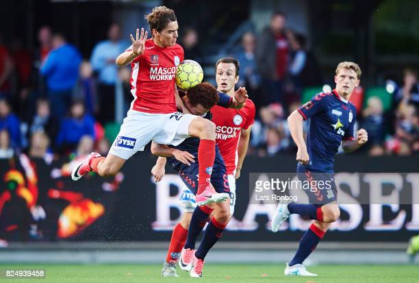Robert Skov of Silkeborg IF and Mustafa Amini of AGF Aarhus compete for the ball during the Danish Alka Superliga match between Silkeborg IF and AGF...