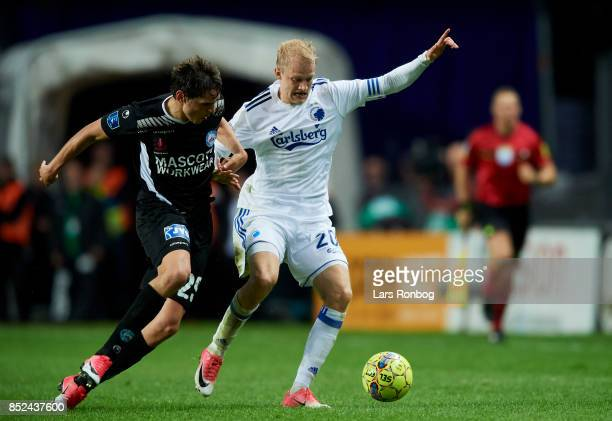 Robert Skov of Silkeborg IF and Nicolai Boilesen of FC Copenhagen compete for the ball during the Danish Alka Superliga match between FC Copenhagen...