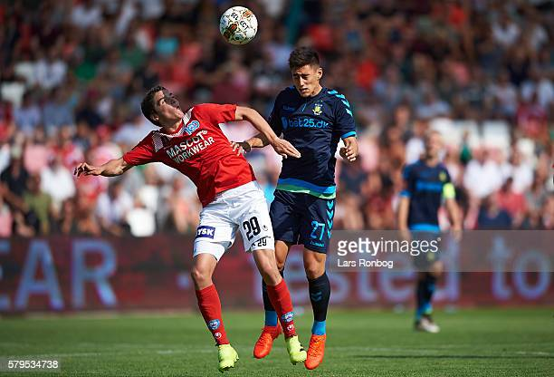 Robert Skov of Silkeborg IF and Svenn Crone of Brondby IF compete for the ball during the Danish Alka Superliga match between Silkeborg IF and...