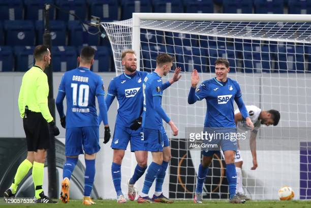 Robert Skov of TSG 1899 Hoffenheim celebrates with his team after he scores their team's second goal during the UEFA Europa League Group L stage...