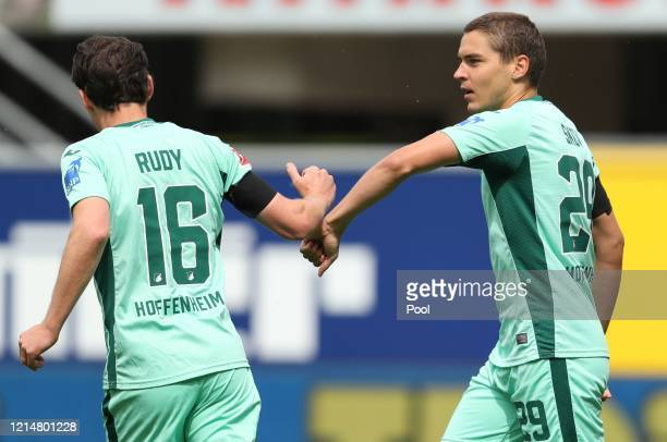 Robert Skov of TSG 1899 Hoffenheim celebrates with teammate Sebastian Rudy of TSG 1899 Hoffenheim after scoring their sides first goal during the...