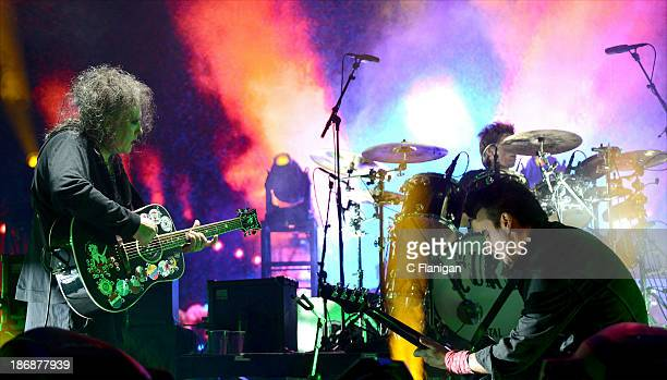 Robert Smith and Simon Gallup of The Cure perform during the 2013 Voodoo Music + Arts Experience at City Park on November 3, 2013 in New Orleans,...