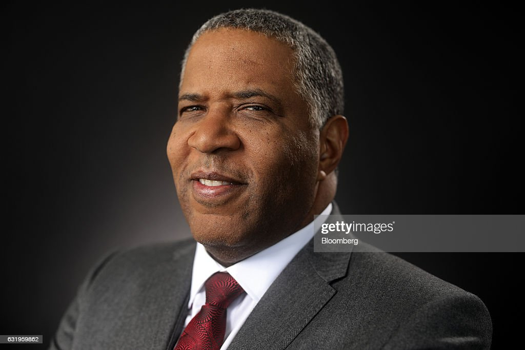 Robert Smith, billionaire and chairman and chief executive officer of Vista Equity Partners LLC, poses for a photograph following a Bloomberg Television interview at the World Economic Forum (WEF) in Davos, Switzerland, on Wednesday, Jan. 18, 2017. World leaders, influential executives, bankers and policy makers attend the 47th annual meeting of the World Economic Forum in Davos from Jan. 17 - 20. Photographer: Simon Dawson/Bloomberg via Getty Images
