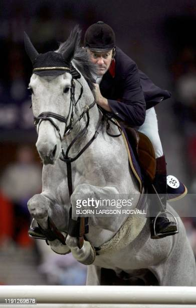 Robert Smith of Great Britain jumps his horse Kalusha to victory at the FEI World Cup Jumping at the Goteborg Horse Show in Goteborg Sweden 25 March...