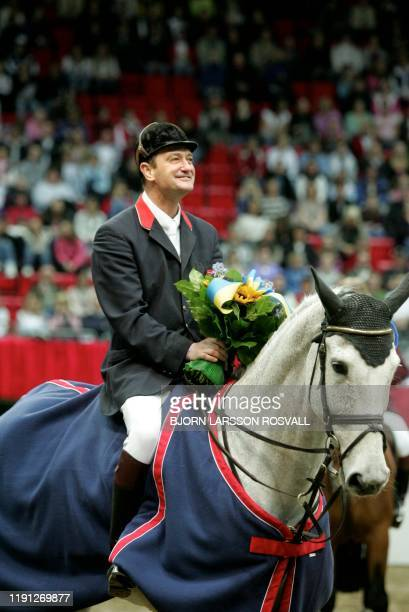 Robert Smith of Great Britain rides his horse Kalusha celebrates after he has won the FEI World Cup Jumping at the Goteborg Horse Show in Goteborg...