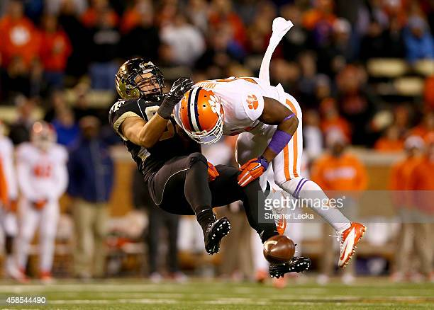 Robert Smith of the Clemson Tigers hits Cam Serigne of the Wake Forest Demon Deacons during their game at BBT Field on November 6 2014 in Winston...