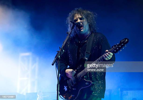 Robert Smith of The Cure performs live on the Main Stage during Day One of Reading Festival 2012 at Richfield Avenue on August 24 2012 in Reading...