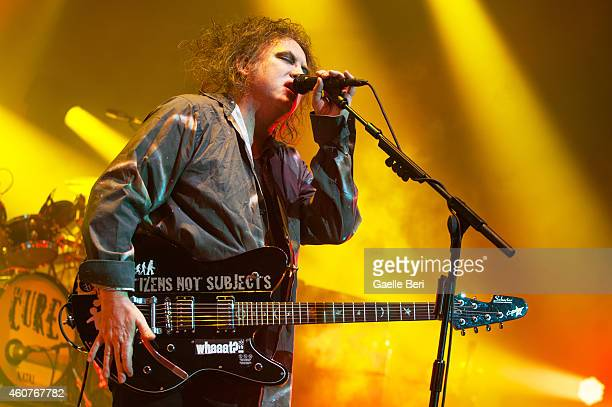 Robert Smith of The Cure performs on stage at Eventim Apollo Hammersmith on December 21 2014 in London United Kingdom