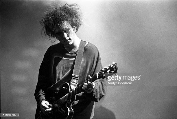 Robert Smith of The Cure performs on stage at Glastonbury Festival United Kingdom 1995