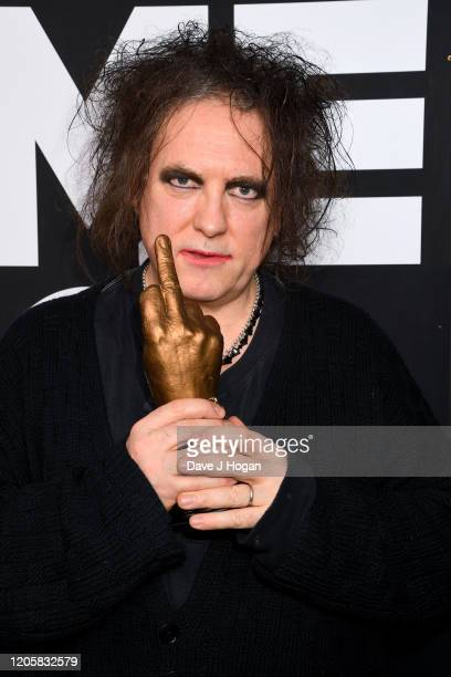 Robert Smith of The Cure poses withthe Awards for Best Festival Headliner during the NME Awards 2020 at O2 Academy Brixton on February 12 2020 in...