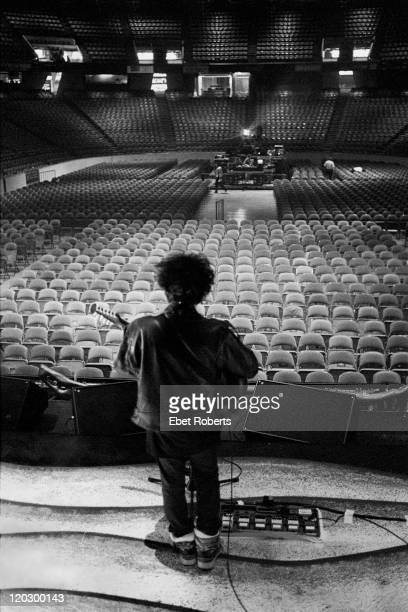 Robert Smith of The Cure viewed from the back of the stage and showing the empty auditorium in front of him during a soundcheck at The Spectrum in...