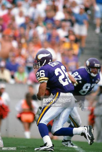 Robert Smith of the Minnesota Vikings carries the ball against the Tampa Bay Buccaneers during an NFL football game October 15 1995 at Tampa Stadium...