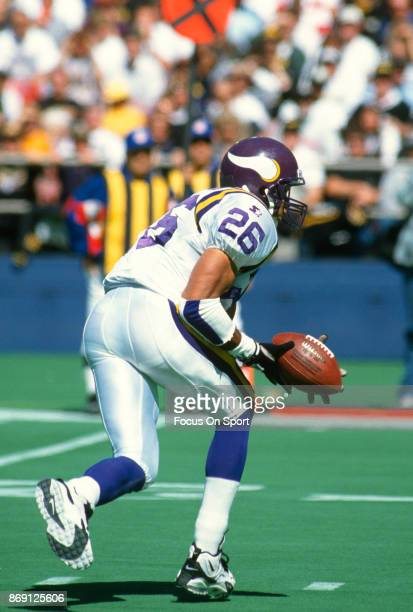 Robert Smith of the Minnesota Vikings carries the ball against the Pittsburgh Steelers during an NFL football game September 24 1995 at Three Rivers...
