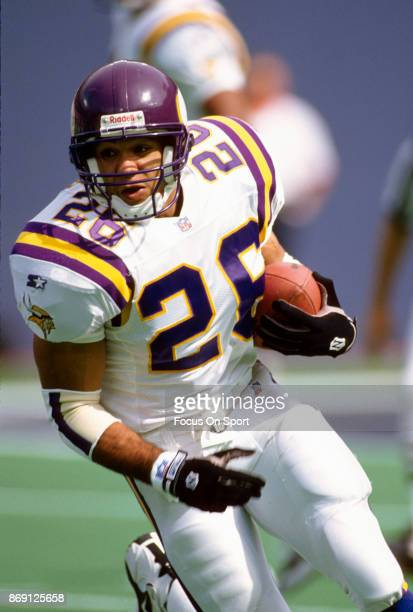 Robert Smith of the Minnesota Vikings carries the ball against the New York Giants during an NFL football game September 29 1996 at Giants Stadium in...