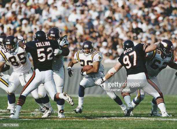 Robert Smith Running Back for the Minnesota Vikings runs with the ball during the National Football Conference Central game against the Chicago Bears...