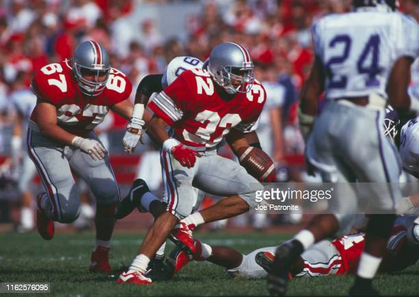 Robert Smith Running Back for the Ohio State Buckeyes runs the ball during the NCAA Big Ten Conference college football game against the Northwestern...
