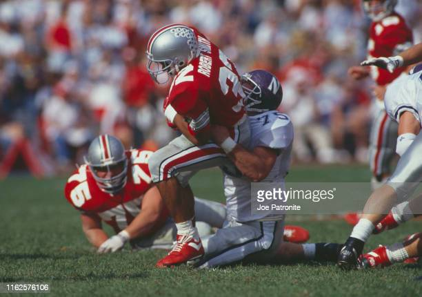 Robert Smith, Running Back for the Ohio State Buckeyes runs the ball during the NCAA Big Ten Conference college football game against the...