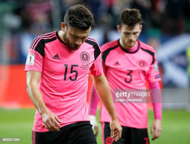 Robert Snodgrass and Andy Robertson of Scotland look dejected after the FIFA 2018 World Cup Qualifier match between Slovenia and Scotland at stadium...