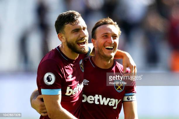Robert Snodgrass and Mark Noble of West Ham United celebrate following their sides win in the Premier League match between West Ham United and...