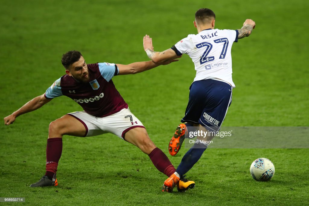 Robert Snodgrass of Aston Villa battles for possession with Mo Besic of Middlesbrough during the Sky Bet Championship Play Off Semi Final second leg match between Aston Villa and Middlesbrough at Villa Park on May 15, 2018 in Birmingham, England.
