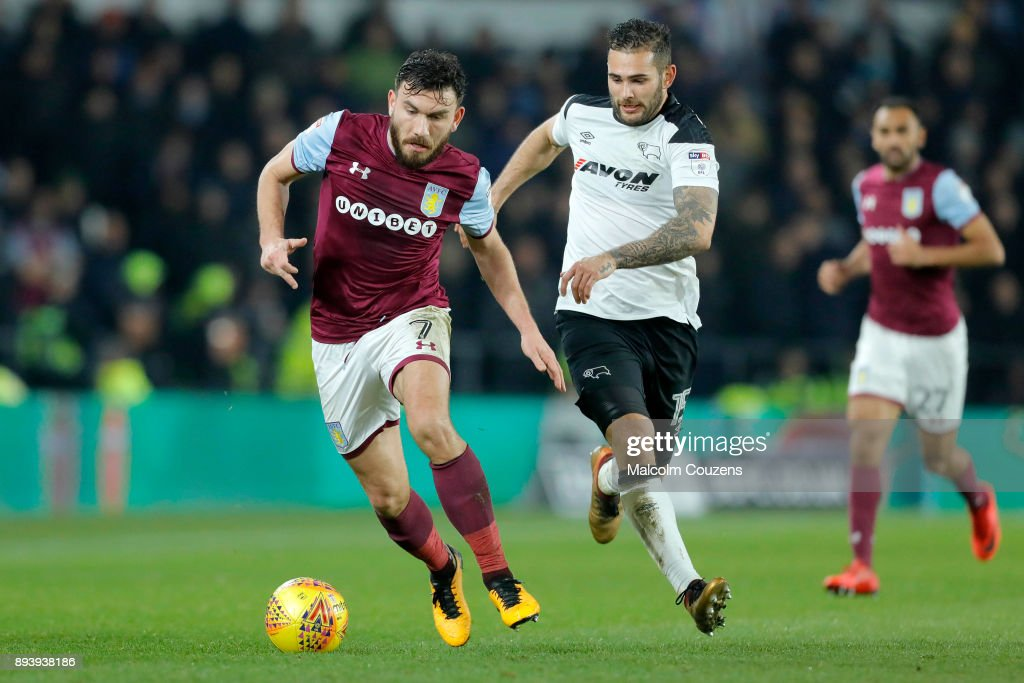 Robert Snodgrass of Aston Villa competes with Bradley Johnson of Derby County during the Sky Bet Championship match between Derby County and Aston Villa at iPro Stadium on December 16, 2017 in Derby, England.