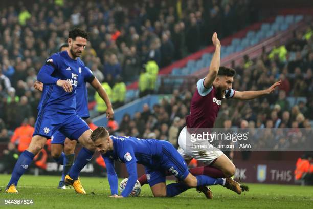 Robert Snodgrass of Aston Villa is deemed to have not been fouled by Joe Bennett of Cardiff City as Aston Villas shouts for a penalty go unanswered...