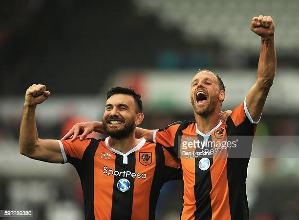 Robert Snodgrass of Hull City and David Meyler of Hull City celebrate after the final whistle during the Premier League match between Swansea City...