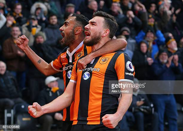 Robert Snodgrass of Hull City celebrates scoring his sides first goal with Ahmed Elmohamady of Hull City during the Premier League match between Hull...