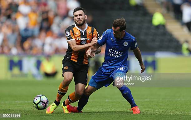 Robert Snodgrass of Hull City is fouled by Christian Fuchs of Leicester City during the Premier League match between Hull City and Leicester City at...
