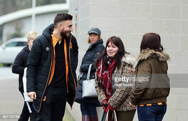 Robert Snodgrass of Hull City speaks with supporters on arrival at the stadium prior to the Emirates FA Cup third round match between Hull City and...
