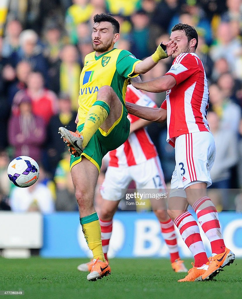 Robert Snodgrass of Norwich City and Erik Pieters of Stoke City battle for the ball during the Barclays Premier League match between Norwich City and Stoke City at Carrow Road on March 08, 2014 in Norwich, England.