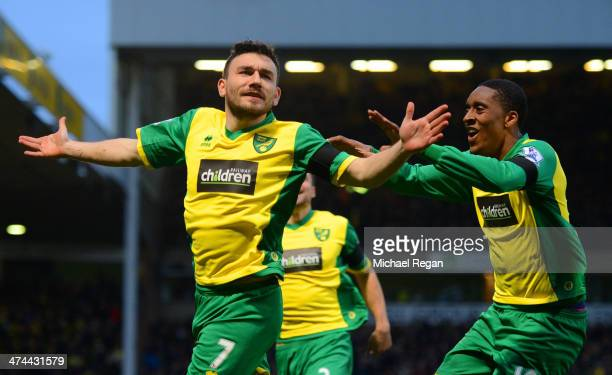 Robert Snodgrass of Norwich City celebrates scoring the opening goal with Leroy Fer of Norwich City during the Barclays Premier League match between...