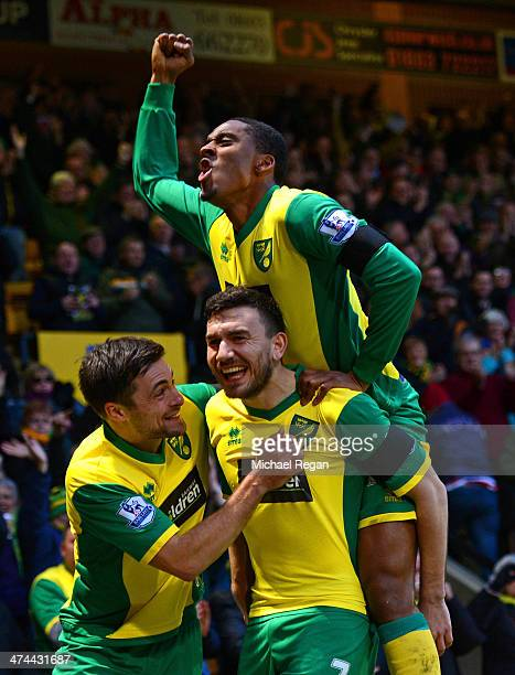 Robert Snodgrass of Norwich City celebrates scoring the opening goal with Leroy Fer and Russell Martin of Norwich City during the Barclays Premier...
