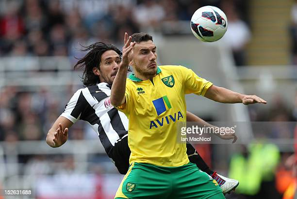 Robert Snodgrass of Norwich City competes with Jonas Gutierrez of Newcastle United during the Barclays Premier League match between Newcastle United...