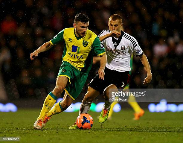 Robert Snodgrass of Norwich City is chased by Steve Sidwell of Fulham during the FA Cup with Budweiser Third round replay match between Fulham and...