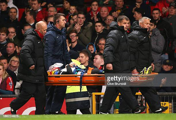 Robert Snodgrass of Norwich City leaves the field on a stretcher during the Capital One Cup fourth round match between Manchester United and Norwich...