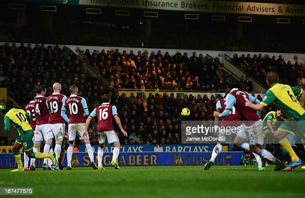 Robert Snodgrass of Norwich City scores their second goal from a free kick during the Barclays Premier League match between Norwich City and West Ham...
