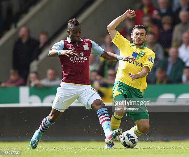 Robert Snodgrass of Norwich City tangles with Yacouba Sylla of Aston Villa during the Barclays Premier League match between Norwich City and Aston...