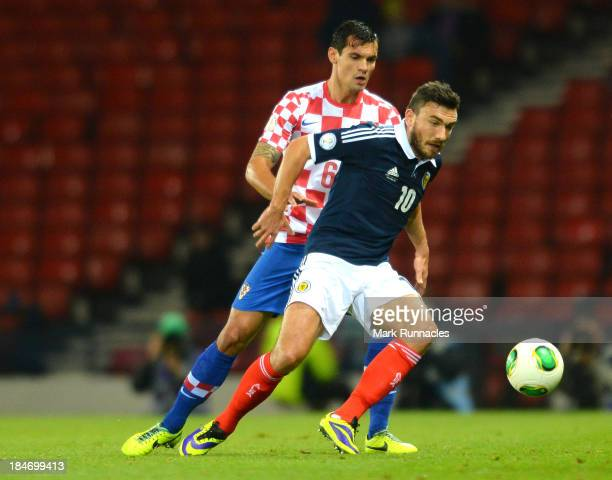 Robert Snodgrass of Scotland battles with Dejan Lovren of Croatia during the FIFA 2014 World Cup Qualifying Group A match between Scotland and...