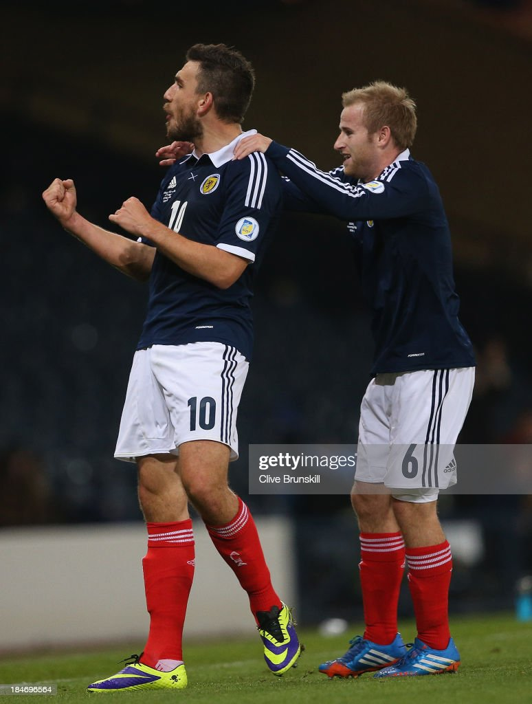 Robert Snodgrass of Scotland celebrates with Barry Bannan after heading the ball past Dejan Lovren of Croatia to score the first goal during the FIFA 2014 World Cup Qualifying Group A match between Scotland and Croatia at Hampden Park on October 15, 2013 in Glasgow, Scotland.