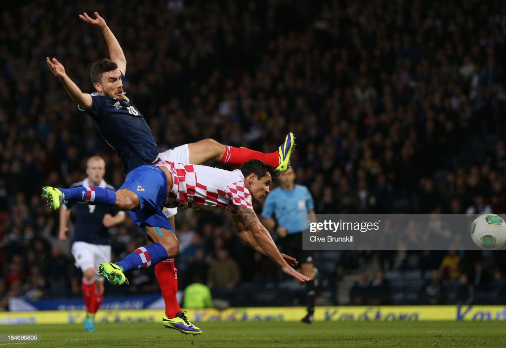 Robert Snodgrass of Scotland heads past Dejan Lovren of Croatia to score the first goal during the FIFA 2014 World Cup Qualifying Group A match between Scotland and Croatia at Hampden Park on October 15, 2013 in Glasgow, Scotland.