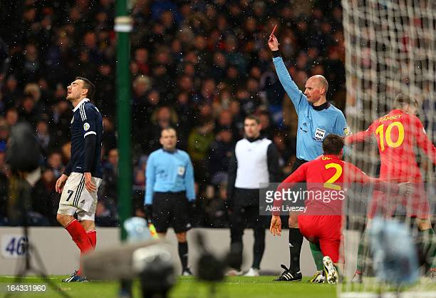 Robert Snodgrass of Scotland is sent off by referee Antony Gautier during the FIFA 2014 World Cup Group A qualifying match between Scotland and Wales...